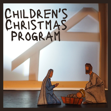 Mary and Joseph are kneeling by the baby Jesus in front of a stable. The words Children's Christmas Program are displayed.